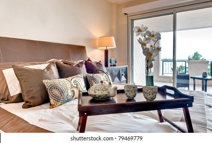 Modern bedroom in apartment  furnished with breakfast tray