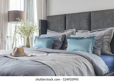 modern bedroom with black color bed tone and set of pillows, interior design