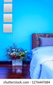 Modern Bedroom decoration with headboard & colorful artificial flower vase on wooden floor / Home improvement design concept