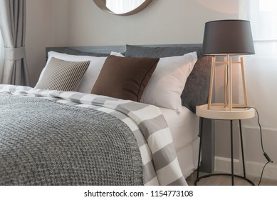 modern bedroom design in grey color tone with wooden modern lamp on round table side, interior design decoration concept