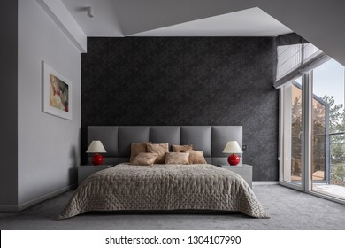 Modern bedroom with double bed, black wallpaper and balcony