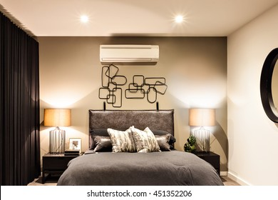 Modern bedroom included flashing table lamps with air conditioner in a luxury house