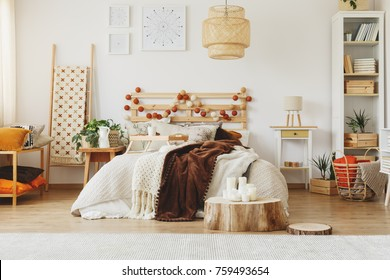 Modern bedroom interior design furnished with king-size bed and a bookshelf