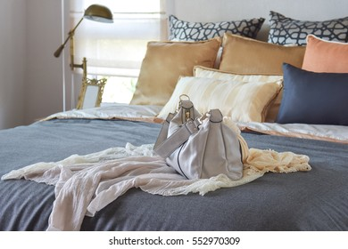 modern bedroom interior with vintage handbag on the bed