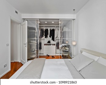 modern bedroom interior with wardrobe with glass door while the floor is made of hardwood