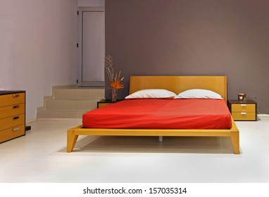 Modern bedroom interior with wooden double bed