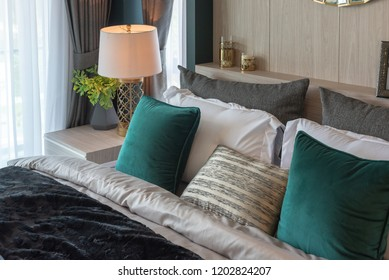 modern bedroom with set of pillows on classic bed, interior decoration design concept