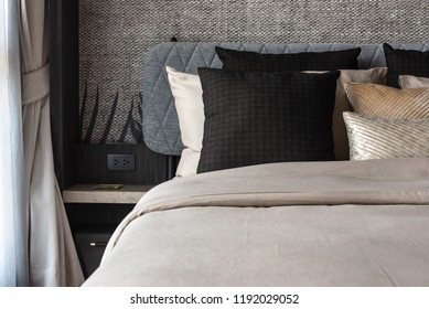 modern bedroom style with set of pillows on bed, interior design decoration concept