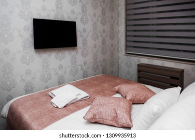 Modern bedroom with a TV