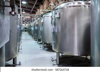 Modern Beer Factory. Small steel tanks for storage and fermentation of beer. Toned image.