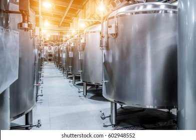 Modern Beer Factory. Small steel tanks for storage and fermentation of beer. Spot light effect