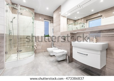 Modern Beige Bathroom With Window, Walk In Shower, Toilet, Bidet, Basin And