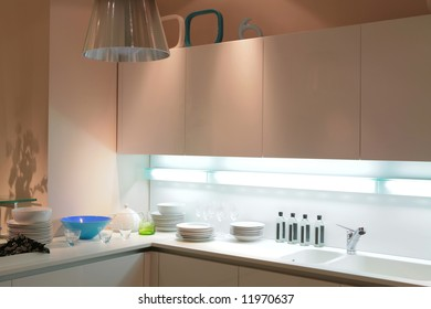 modern beige kitchen with blue tureen and shade on the wall