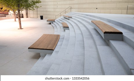 Modern benches and concrete stairway in the city square on a sunny day,Public spaces in city park