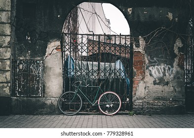 Modern Bicycle infront of an old wall