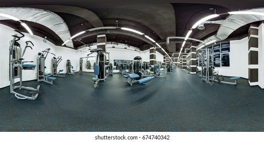 Modern big empty fitness gym with sport exercise equipment full 360 degree panorama in equirectangular spherical projection