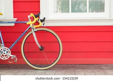 Modern bike stand near wooden wall, Sport or Recreation concept