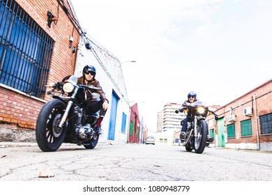 Modern bikers speeds up motorcycle on a industrial street. Outdo