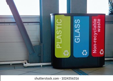 Modern bins to collect plastic, glass and non-recyclable waste. Concept: garbage collection management system and recycling of solid household waste. Trash cans.