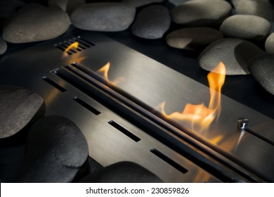 Modern bio fireplace made of stainless steel with a burning fire