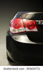 modern black car rear view close up
