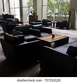 Modern black couch and wooden table decoration
