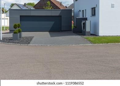 modern black garage in suburban street in south germany countryside near city stuttgart