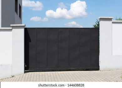 modern black gate and sky in the background