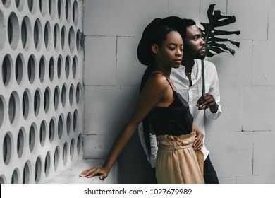Modern black man and caucasian woman in a town.