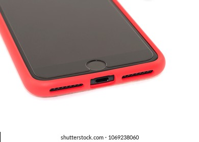 Modern black smart phone with protective glass and red bumper cover