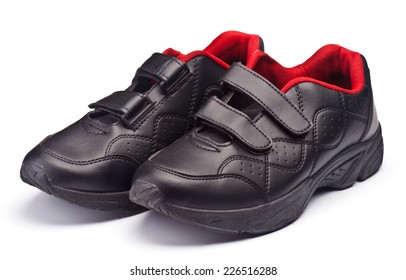 modern black sports shoes; isolated on white
