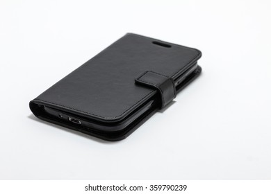 Modern Black Touchscreen Smart Phone on Leather Case isolated on white background