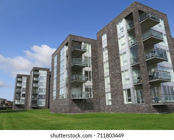 Modern blocks of flats with grassy view on harbor front in Graasten, Denmark