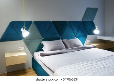 Modern blue bedroom with two lamps