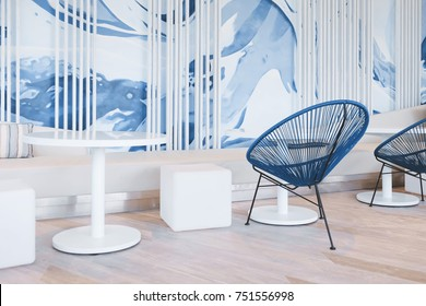 Modern blue cafe interior with blue wave painting wall.