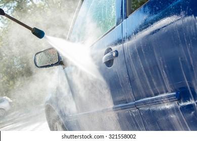 Modern blue car in a car wash