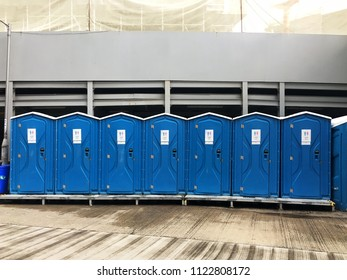The modern blue strong plastic public toilet are at the street outdoor so clean and convenience for people and tourist in Hongkong, China.