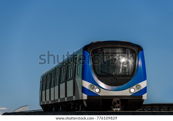 modern blue train carriage on the sky background, bottom view