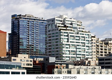 Modern blue and white buildings in a city skyline