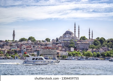 Modern Boat on Golden Horn with a view of the Historic Süleymaniye Mosque on Hill in Istanbul's Old City - Istanbul, Turkey