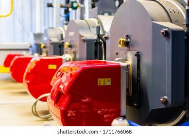 Modern boiler room equipment - high power boiler burner. Boiler room. Water heating. Power supply. Water supply.