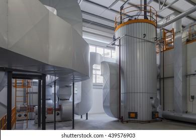 Modern boiler room on the wooden chips.