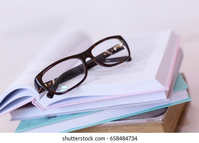 Modern book and eye glasses for read and write - selective focus