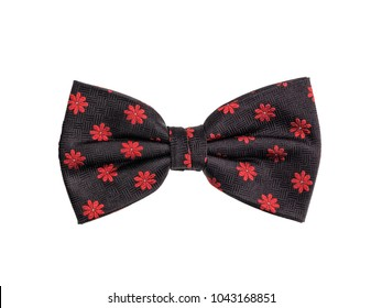 Modern bow tie made of black pattern fabric with little red flowers, isolated on white background.