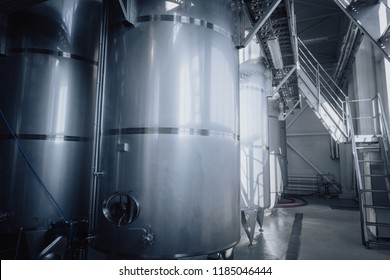 Modern brandy production steel tanks and pipes, machinery tools and vats, brandy production.