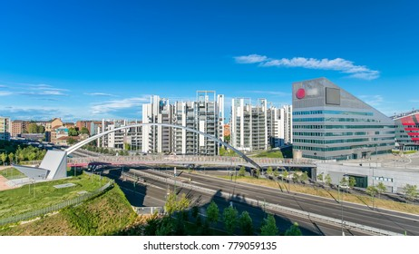 Modern bridge and buildings in the new area of Portello timelapse, Milan, Italy. Top view with traffic on the road.