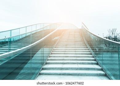 modern bridge with glass handrail