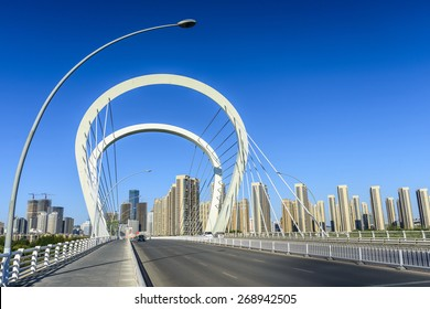 Modern bridge  and skyscraper. Located in Shenyang City, Liaoning province, China.