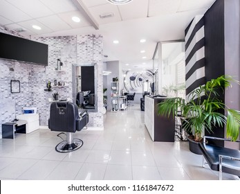 Modern bright beauty salon or baber shop. Hair salon interior business with black and white luxury decor.