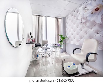 Modern bright beauty salon. Manicure and pedicure interior luxury business